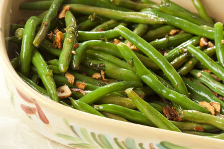 french bean: Fresh Organic Cooked Green Beans in a bowl Stock Photo