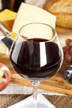 Red Wine And Assorted Cheese Plate with fruit photo