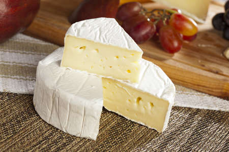 Fresh Organic White Brie Cheese on a background