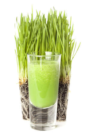 Green Organic Wheat Grass Shot ready to drink Stock Photo