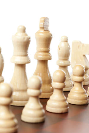 Classic Wooden Chessboard with Cheese Pieces against a background photo