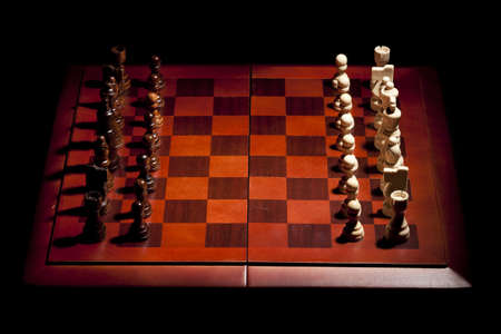 Classic Wooden Chessboard with Cheese Pieces against a background Stock Photo - 17168811