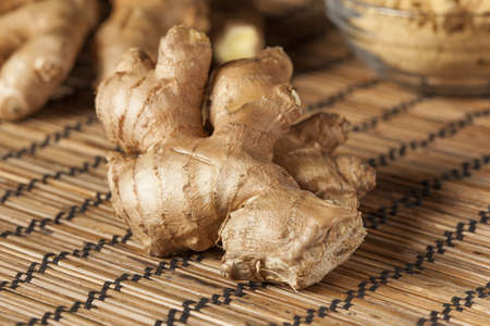 Fresh Organic Oriental Ginger on a background photo