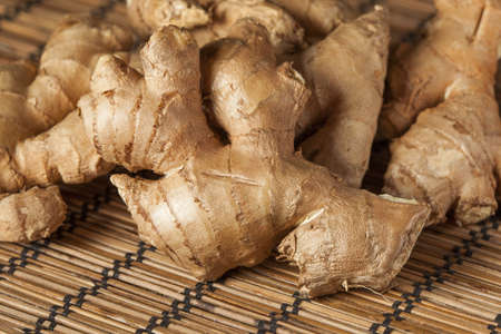 fresh ginger: Fresh Organic Oriental Ginger on a background Stock Photo
