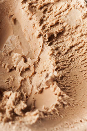 Cold Organic Chocolate ice Cream against a background photo