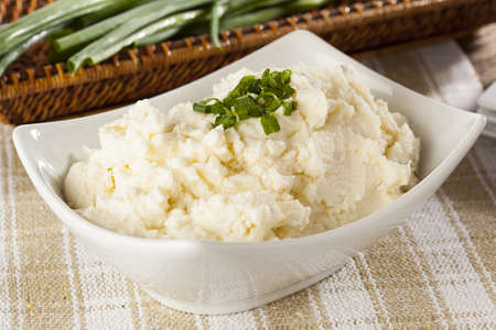 spud: Fresh Homemade Mashed Potatoes against a background