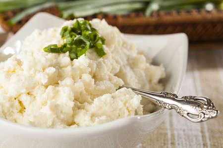 Sour cream: Fresh Homemade Mashed Potatoes against a background