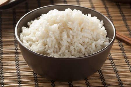 basmati: Bowl of Organic White Rice with chop sticks