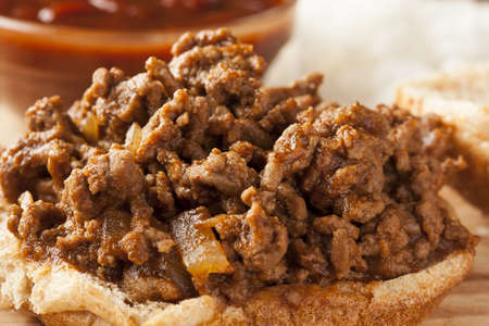Sloppy Barbecue Beef Sandwich on a whole wheat bun photo