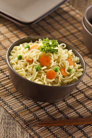 thai noodle soup: Homemade Quick Ramen Noodles with carrots and peas
