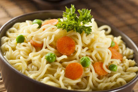 cooked instant noodle: Homemade Quick Ramen Noodles with carrots and peas