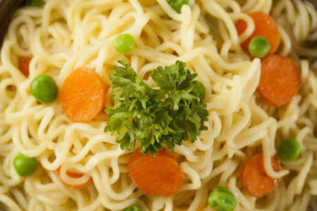 instant noodle: Homemade Quick Ramen Noodles with carrots and peas