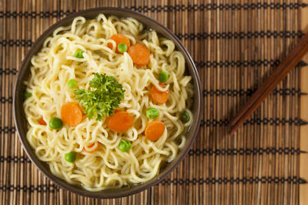 Homemade Quick Ramen Noodles with carrots and peas photo
