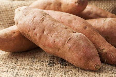 tuber vegetables: Fresh Organic Orange Sweet Potato against a background Stock Photo