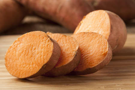 背景に新鮮な有機オレンジ スイート ポテト 写真素材 - 17545127