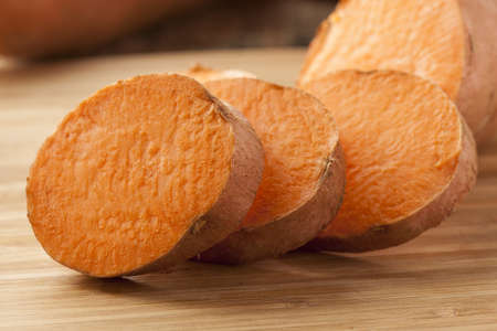 tuber: Fresh Organic Orange Sweet Potato against a background Stock Photo