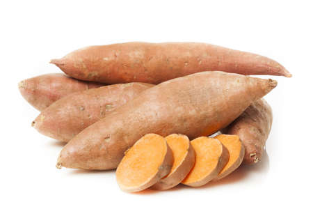 jhy: Fresh Organic Orange Sweet Potato against a background Stock Photo