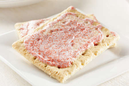 Hot Strawberry Toaster Pastry with frosting and sprinkles photo