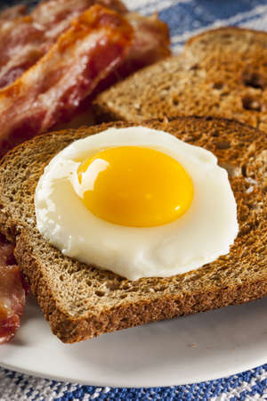 sunnyside: Organic Sunnyside up Egg with toast and bacon for breakfast