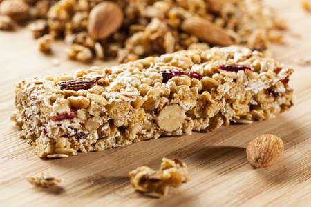 fruit bars: Organic Almond and Raisin Granola Bar on a background Stock Photo
