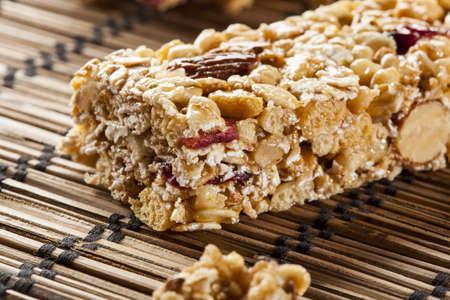 granola bar: Organic Almond and Raisin Granola Bar on a background Stock Photo