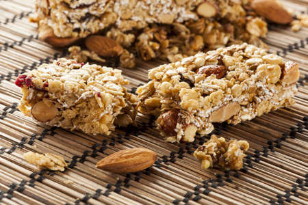 Organic Almond and Raisin Granola Bar on a background photo