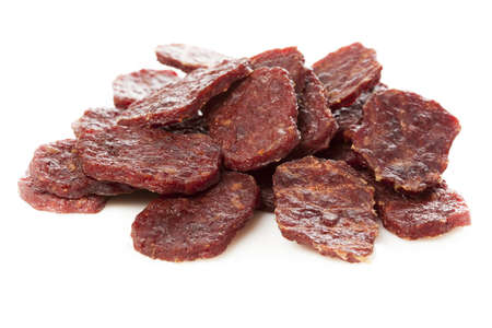 marinate: Dried Processed Beef Jerky against a background Stock Photo
