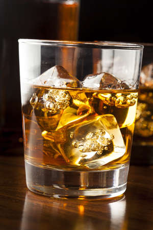 whisky glass: Golden Brown Whisky on the rocks in a glass