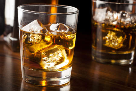 Golden Brown Whisky on the rocks in a glass photo
