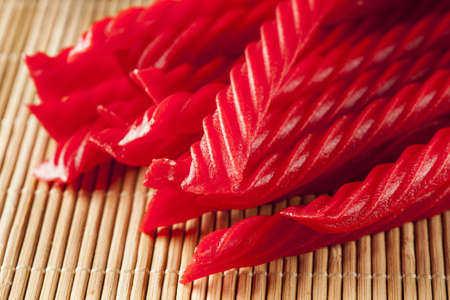 licorice: Bright Red Licorice Candy shaped like a twisted rope Stock Photo
