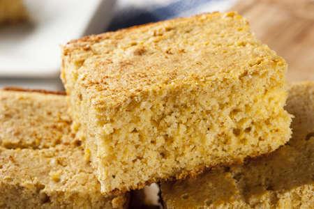 cornbread: Golden Organic Homemade Cornbread cut into squares