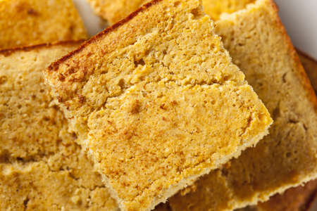 Golden Organic Homemade Cornbread cut into squares photo