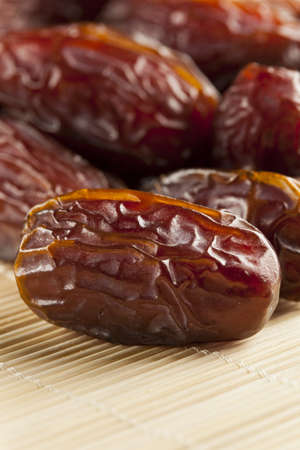 Fresh Organic Raw Brown Date Fruit against a background photo