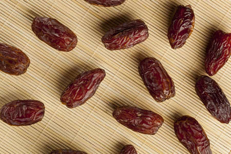 Fresh Organic Raw Brown Date Fruit against a background Stock Photo - 18724540