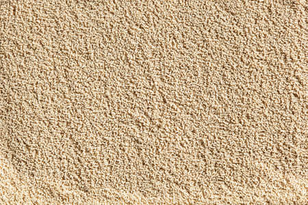 leavening: Organic Raw Yeast for baking bread against a background