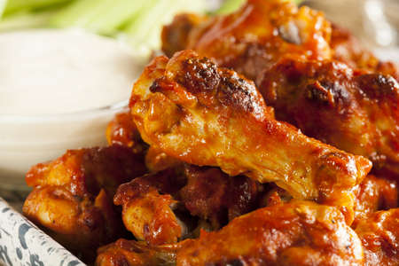 Hot and Spicey Buffalo Chicken Wings with celery photo