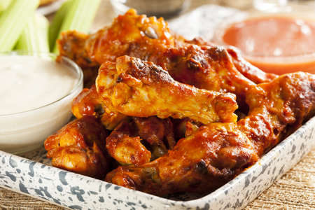 hot wings: Hot and Spicey Buffalo Chicken Wings with celery