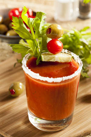 bloody mary: Spicy Bloody Mary Alcoholic Drink with a tomato garnish