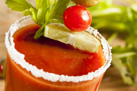 Spicy Bloody Mary Alcoholic Drink with a tomato garnish photo