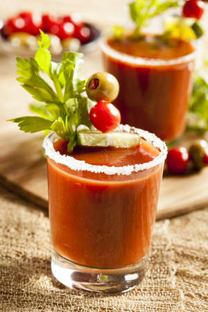 Spicy Bloody Mary Alcoholic Drink with a tomato garnish