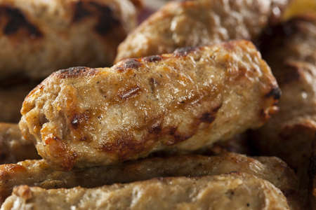 Organic Cooked Maple Breakfast Sausage on a background photo