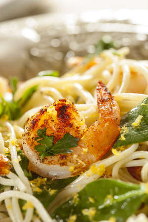 Homemade Lemon and Shrimp Pasta with spinach and parsley photo