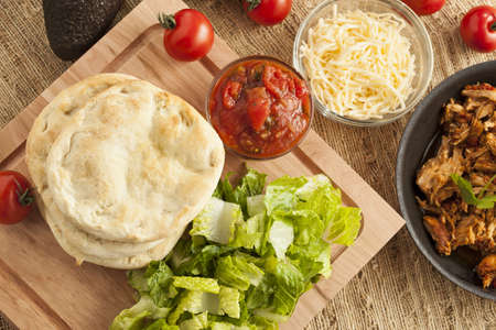 Homemade Mexican Flatbread Taco with meat, lettuce, cheese, and salsa photo