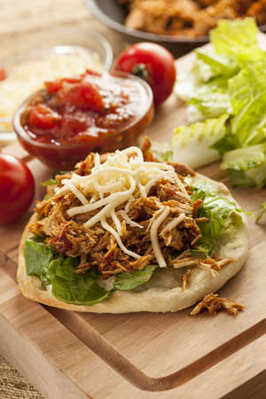 tortillas: Homemade Mexican Flatbread Taco with meat, lettuce, cheese, and salsa Stock Photo