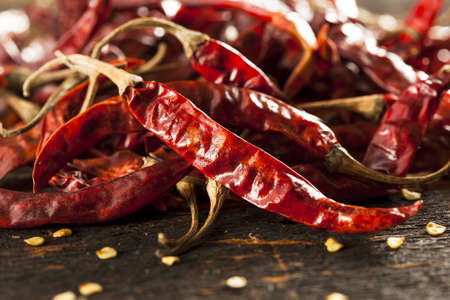 red chilli: Organic Dried Red Hot Peppers in a bunch Stock Photo