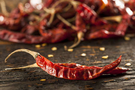 Organic Dried Red Hot Peppers in a bunch Imagens