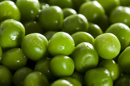 green peas: Fresh Green Organic Cooked peas against a background Stock Photo