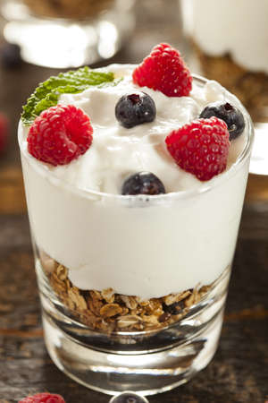 Homemade Organic Fresh Fruit Parfait with berries and granola photo