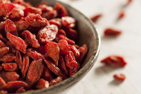 Organic Dried Goji Berries against a background Stock Photo - 19448449