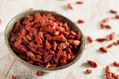 Organic Dried Goji Berries against a background photo